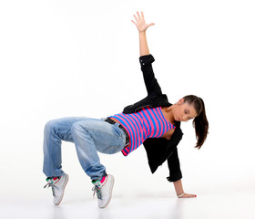 Attractive brunette performing dancing steps, hip hop