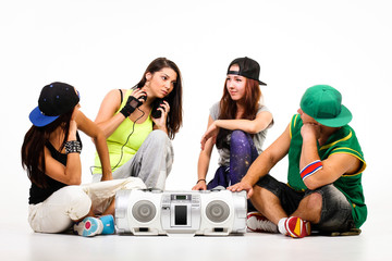 Hip hop gang: one male, three females. Listening boombox
