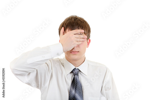 Teenager Covering his Eyes