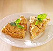 two pieces of apple pie with mint garnish.