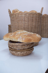 Bread baton in bamboo basket