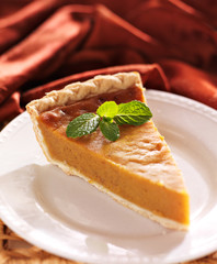 pumpkin pie with mint garnish