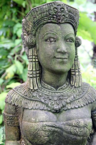 Ancient statue of a woman in the garden.