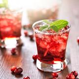 Fototapeta cranberry cocktail with mint garnish.