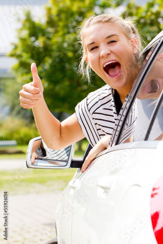 Excited girl in her new car