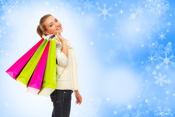 Girl with bags on blue snowy background
