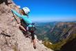 canvas print picture - Kind beim Klettern am Klettersteig