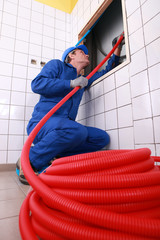 Plumber fixing some pipes