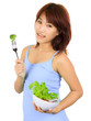 Young asain woman with a bowl of vegetable salad