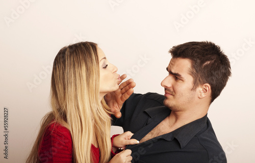 Girl trying to kiss a guy