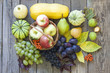 Fruits and vegetables in autumn season on vintage wooden boards