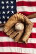 Vintage baseball, bat and glove on American flag