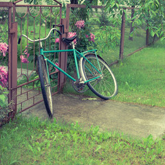 old vintage bicycle near the fence