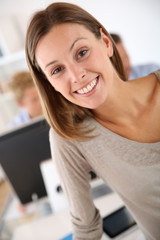 Smiling young woman in office