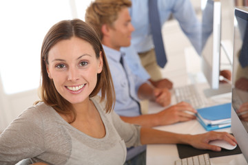 Woman in business training sitting in front of desktop