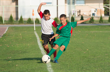 kids playing defense on football match