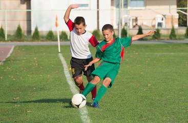 kids playing defense on football match