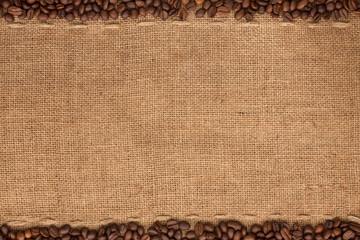 Coffee beans lying on sackcloth