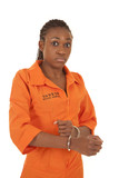woman prisoner orange handcuff looking