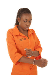 woman prisoner orange handcuff look down