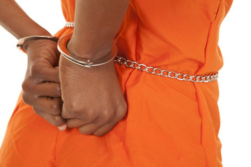 woman prisoner orange hancuffs up close
