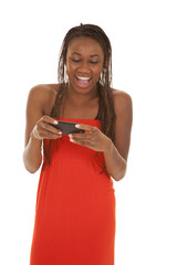woman red dress phone laugh look down
