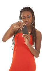 woman red dress phone serious looking