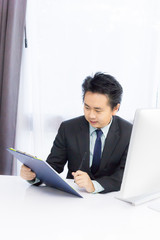 business man working with notepad and desktop computer