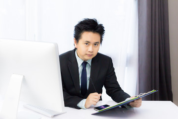 business man working with smart phone and desktop computer