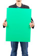 man holding blank green board