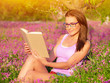Woman read book outdoors