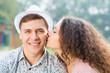 girl kissing a man on the cheek