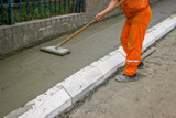 Worker leveling fresh Concrete 4