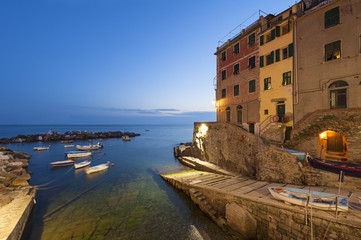 Small harbor of Riomaggiore at dusk
