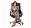 Attractive business woman sitting in chair, isolated over white