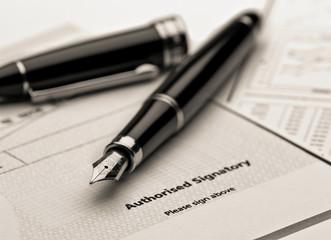 Fountain pen on legal document.