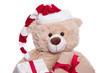 Teddybär als Weihnachtsmann isoliert in Rot und Weiß
