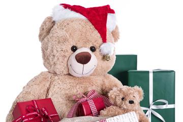 Teddy als Weihnachtsmann isoliert mit Geschenken