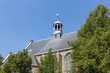 Dutch church with slate roof against a blue sky