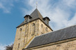 Dutch church with tower against a blue sky
