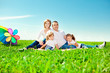 Happy family in outdoor park  at sunny day. Mom, dad and two dau