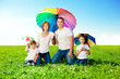 Happy family together in outdoor park  at sunny day. Mom, dad an