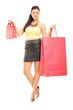 Attractive female holding shopping bags