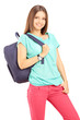 Smiling female student with a backpack looking at camera