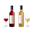 Red and white wine bottles and grapes isolated on white