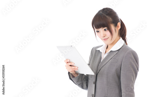 asian businesswoman using tablet computer
