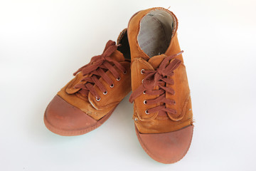 pair of old brown canvas shoes