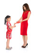 Asian Chinese child receiving monetary gift from parent