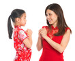 Chinese parent and child greeting to each other