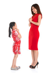 Full length Chinese parent and child greeting to each other